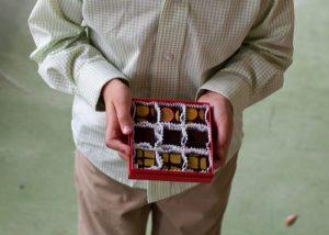 child giving Delysia chocolate truffles